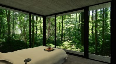 Main-Bedroom-of-Gres-House-with-3-Walls-of-Floor-to-Ceiling-Windows